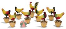 A SET OF STEIFF PRE-BUTTON FELT HEN SKITTLES, (Hen), multicoloured, black bead eyes, wire legs wrapped in string, nailed to turned tapering wooden bases, green and pink ball, circa 1903, the cockerel kingpin --7in. (18cm.) high and the eight hens --6in. (15cm.) high (missing one ball)  (10)