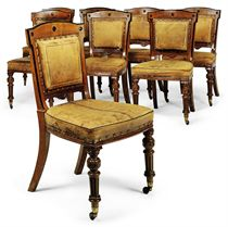 A SET OF EIGHT LATE VICTORIAN OAK AND EBONISED SIDE CHAIRS