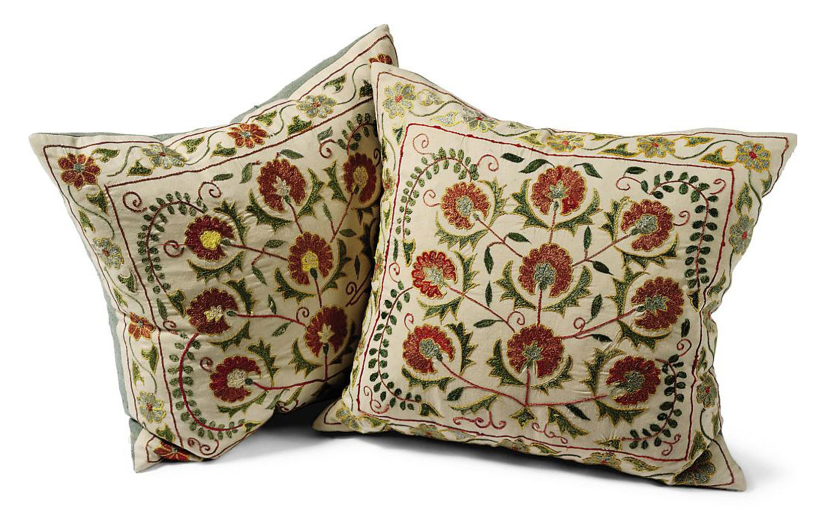 A pair of susani silk embroidered cushions by robert