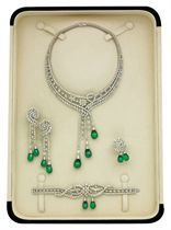 AN ELEGANT EMERALD AND DIAMOND PARURE, BY ELIE CHATILA