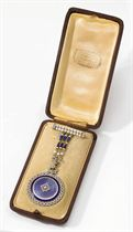 Musson. A fine Belle Epoque 18K two colour gold, enamel and diamond-set openface pendant watch with matching brooch