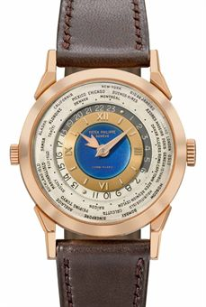 Patek Philippe. An exceptionally rare and highly important 18K pink gold two crown world time wristwatch with 24 hour indication and blue enamel dial