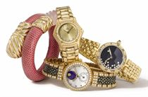 Barthelay, Corum, Gerald Genta, Ebel. A lot of five lady's 18K gold and diamond-set wristwatches