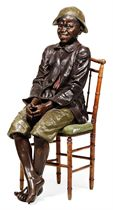 A LIFE-SIZE AUSTRIAN POLYCHROME TERRACOTTA FIGURE OF A SEATED BOY
