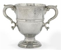 A GEORGE II IRISH SILVER TWO-HANDLED CUP