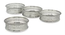 A SET OF FOUR GEORGE III SILVER WINE-COASTERS