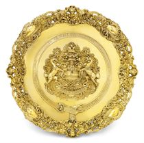 AN IMPORTANT GEORGE IV IRISH SILVER-GILT CHARGER