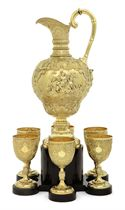 A VICTORIAN SILVER-GILT EWER AND SIX GOBLETS