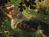 A girl reading in a hammock
