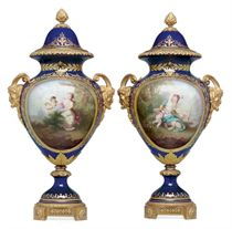 A PAIR OF ORMOLU-MOUNTED SEVRES STYLE PORCELAIN COBALT-BLUE GROUND VASES AND COVERS