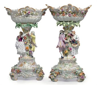 TWO MEISSEN PORCELAIN FLOWER-ENCRUSTED FIGURAL CENTERPIECES AND STANDS