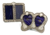A VICTORIAN SILVER HEART-SHAPED DOUBLE PHOTOGRAPH FRAME
