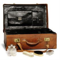 A FRENCH LEATHER, SILVER MOUNTED AND IVORY GENTLEMAN'S TRAVE