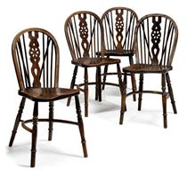 A SET OF FOUR VICTORIAN WHEEL-BACK WINDSOR CHAIRS