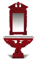 A CARVED AND RED-PLUSH COVERED MIRROR AND CONSOLE EN SUITE