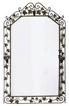 A FRENCH WORKED STEEL MIRROR