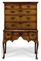 A GEORGE II ELM AND BURR ELM AND FEATHER-BANDED CHEST ON STA