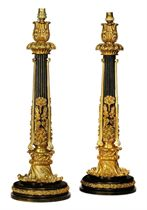 A PAIR OF GILT AND PATINATED BRONZE TABLE LAMPS