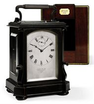A VICTORIAN GIANT PATINATED-BRASS EIGHT DAY STRIKING AND REPEATING CARRIAGE CLOCK