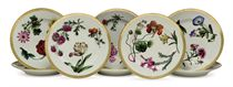 A Set of Eight Porcelain Dessert Plates