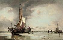 Dutch pincks beached on the shore at Scheveningen with fishermen unloading the day's catch