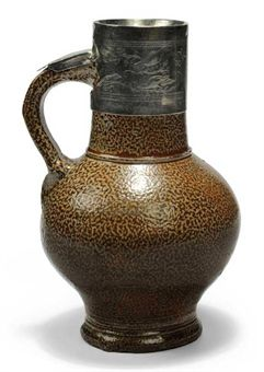A RHEINISH SALT-GLAZED 'TIGERWARE' JUG WITH SILVER MOUNTS