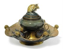 A DOULTON LAMBETH STONEWARE 'MOUSE' INKWELL BY GEORGE TINWORTH, WITH BRASS MOUNTS