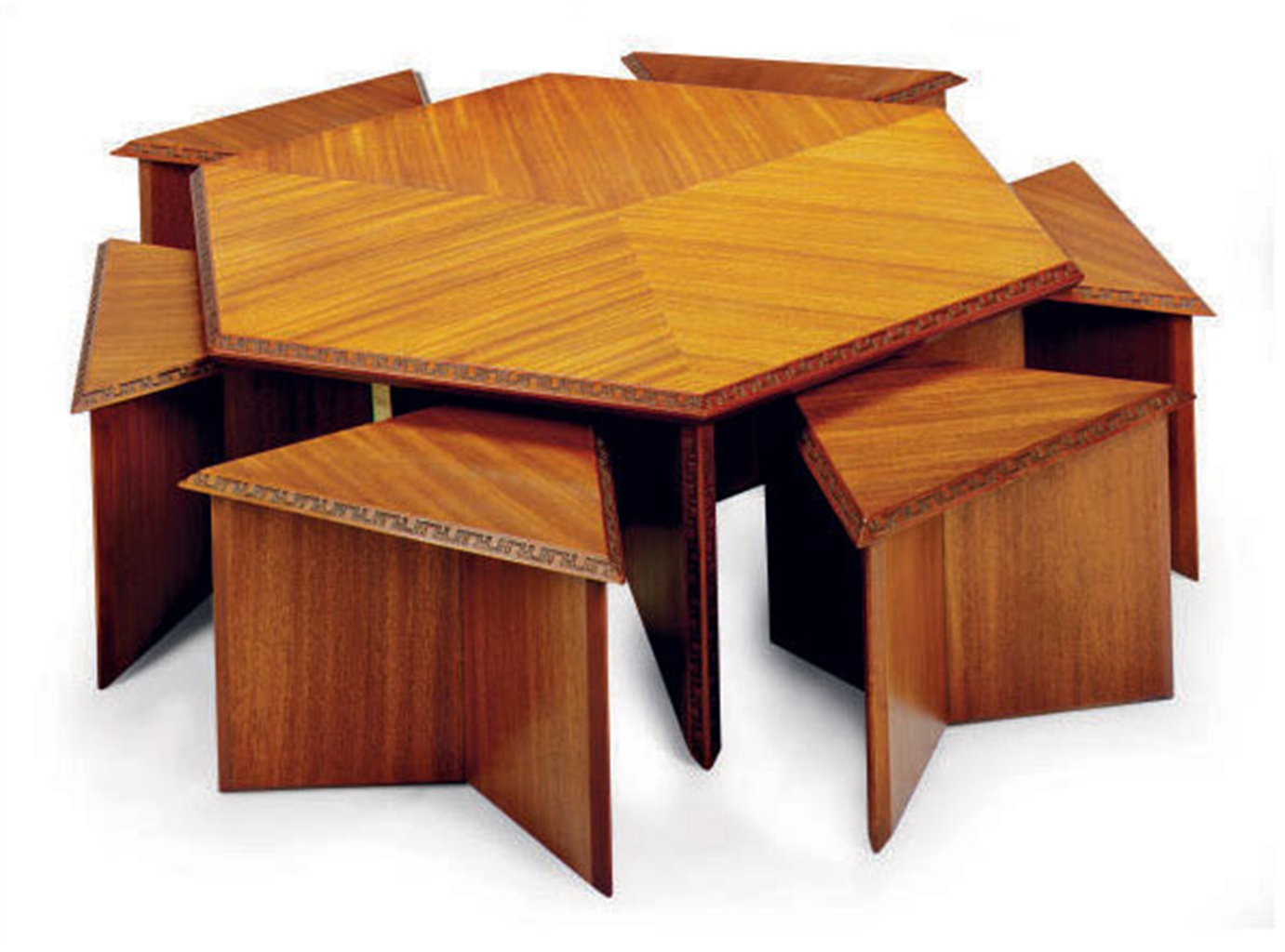 A Mahogany Taliesin Hexagonal Low Dining Table With Six
