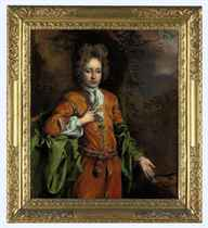Portrait of a boy, three-quarter-length, in Eastern dress, in a wooded landscape, with a hound