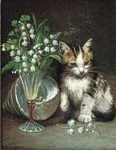 A kitten with a shell and flowers in a glass vase