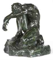 A FRENCH BRONZE FIGURE OF A KNEELING MAN 'LE CONQUIS'