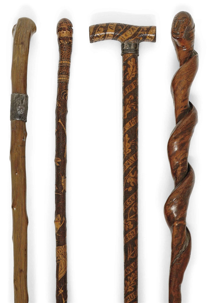 Wooden Walking Sticks ~ Four british carved wood walking sticks th century