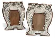 A MATCHED PAIR OF EDWARDIAN ART NOUVEAU SILVER PHOTOGRAPH FRAMES