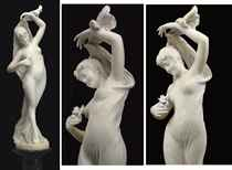 AN ITALIAN MARBLE FIGURE OF A SCANTILY-CLAD MAIDEN
