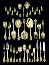 AN EXTENSIVE GRAND BAROQUE GOLD FLATWARE SERVICE