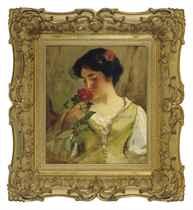 A beauty smelling a rose