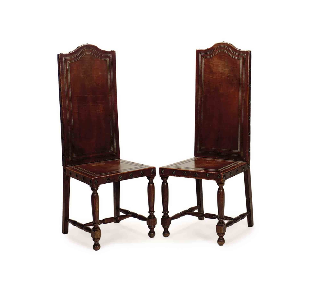Tall Dining Chairs: A PAIR OF EMBOSSED LEATHER AND OAK TALL BACK DINING CHAIRS