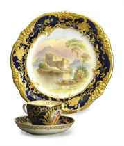 A SET OF EIGHT ENGLISH BLUE GROUND TOPOGRAPHICAL PLATES AND A SET OF NINE GERMAN TEACUPS AND SAUCERS,