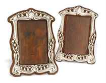 A MATCHED PAIR OF LATE VICTORIAN/EDWARDIAN ART NOUVEAU SILVER PHOTOGRAPH FRAMES