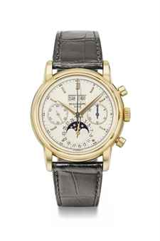 Patek Philippe. A very fine and rare 18K gold perpetual calendar chronograph wristwatch with moon phases, original certificate, envelope and box