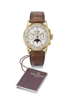 Patek Philippe. An extremely fine and rare 18K gold perpetual calendar chronograph wristwatch with moon phases