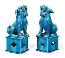 A PAIR OF CHINESE TURQUOISE-GLAZED BUDDHIST LIONS