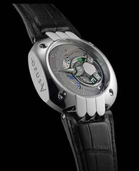 HARRY WINSTON. AN UNUSUAL, LARGE AND RARE LIMITED EDITION PLATINUM WRISTWATCH WITH 3-DIMENSIONAL SATELLITE HOUR DISPLAY, RETROGRADE MINUTES, 5 DAYS POWER RESERVE, DAY/NIGHT AND 5 YEARS SERVICE INDICATORS