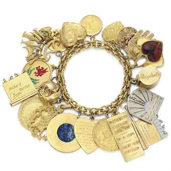 A GOLD AND MULTI-GEM CHARM BRACELET
