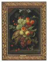 Peaches, grapes, nectarines, strawberries, cherries, corn, a pomegranate and other fruit hanging from a blue ribbon in a niche