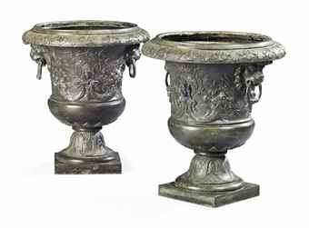 A PAIR OF BRONZE CAMPANA URNS
