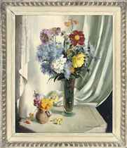 Chrysanthemums, daisies and other flowers in a glass vase