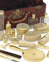 A GOLD ASSEMBLED LADY'S TOILET SERVICE