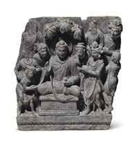 A gray schist relief of Buddha with attendants