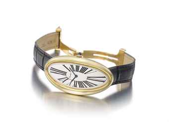 Audemars Piguet, made for Cartier. A fine and unusual 18K gold oversized oval curved wristwatch